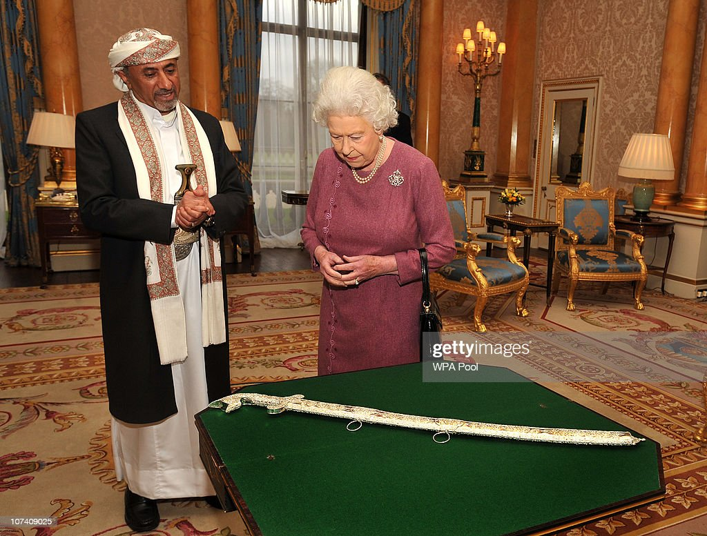 Queen <a gi-track='captionPersonalityLinkClicked' href=/galleries/search?phrase=Elizabeth+II&family=editorial&specificpeople=67226 ng-click='$event.stopPropagation()'>Elizabeth II</a> is presented with a sword as a gift from the Ambassador of Yemen, Abdulla Ali Al-Radhi, as he visits the Queen to receive his credentials during a private meeting at Buckingham Palace on December 8, 2010 in London, England.