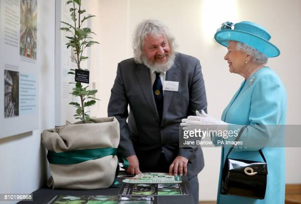 Queen Elizabeth II is presented with an Arran Whitebeam tree by curator David Knott from the Royal Botanic Garden Edinburgh during a visit to the...