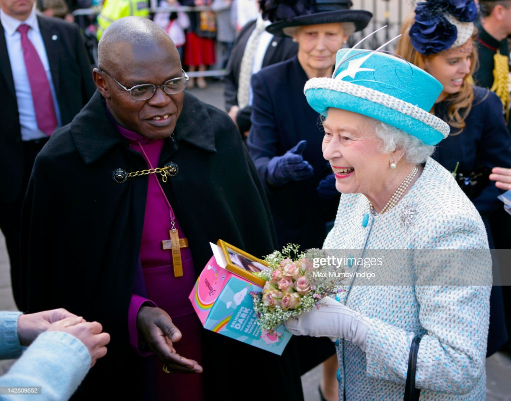 Queen <a gi-track='captionPersonalityLinkClicked' href=/galleries/search?phrase=Elizabeth+II&family=editorial&specificpeople=67226 ng-click='$event.stopPropagation()'>Elizabeth II</a> (accompanied by Dr <a gi-track='captionPersonalityLinkClicked' href=/galleries/search?phrase=John+Sentamu&family=editorial&specificpeople=623109 ng-click='$event.stopPropagation()'>John Sentamu</a>, The Archbishop of York) is presented with an Easter Egg by a member of the public during a walkabout outside the Mansion House whilst on a visit to York, after attending the Maundy Thursday Church Service at York Minster on April 5, 2012 in York, England.