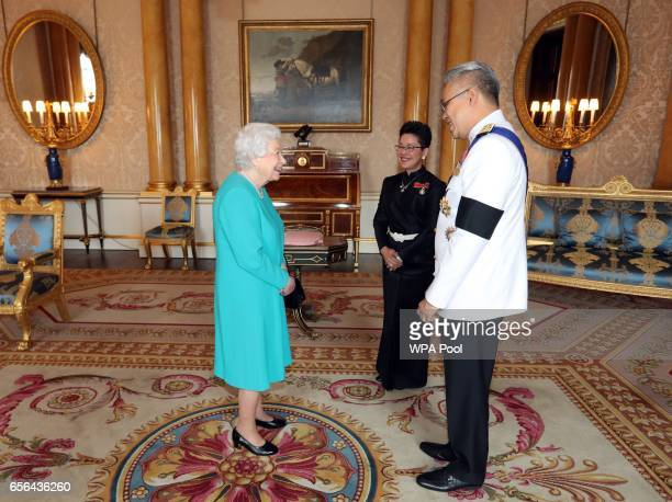 Queen Elizabeth II is presented with Letters of Credence by the Ambassador from the Kingdom of Thailand Mr Pisanu Suvanajata accompanied by his wife...