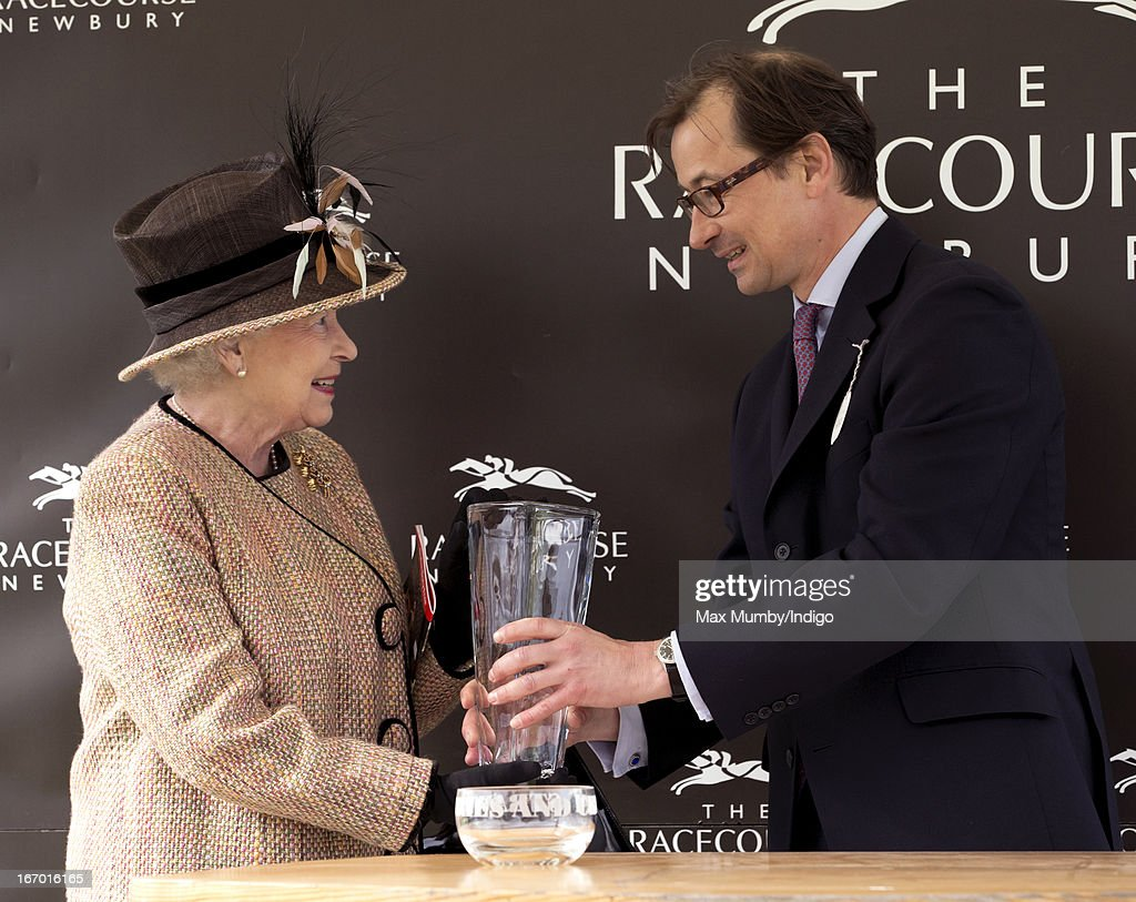 Queen <a gi-track='captionPersonalityLinkClicked' href=/galleries/search?phrase=Elizabeth+II&family=editorial&specificpeople=67226 ng-click='$event.stopPropagation()'>Elizabeth II</a> is presented with the winning owners trophy after her horse 'Sign Manual' won the Dreweatts Handicap Stakes during the Dubai Duty Free Raceday at Newbury Racecourse on April 19, 2013 in Newbury, England.