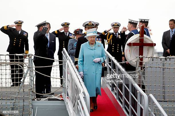 Queen Elizabeth II is saluted by the Officers of HMS Lancaster at Portsmouth Naval Base as she leaves the ship after a visit to the ship on May 20...