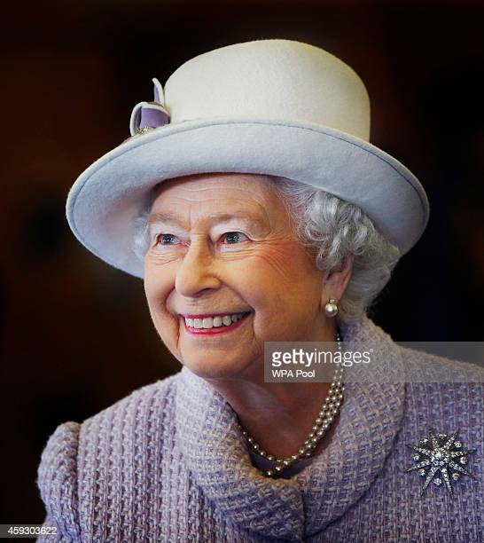 Queen Elizabeth II is seen during a visit to RAF Lossiemouth on her 67th wedding anniversary on November 20 2014 in Lossiemouth Scotland It was the...