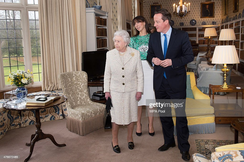 Queen <a gi-track='captionPersonalityLinkClicked' href=/galleries/search?phrase=Elizabeth+II&family=editorial&specificpeople=67226 ng-click='$event.stopPropagation()'>Elizabeth II</a> is shown around Chequers by Prime Minister <a gi-track='captionPersonalityLinkClicked' href=/galleries/search?phrase=David+Cameron+-+Politician&family=editorial&specificpeople=227076 ng-click='$event.stopPropagation()'>David Cameron</a> where she and Prince Philip, Duke of Edinburgh had lunch with the PM and his wife Samantha, on February 28, 2014 near Aylesbury, England. It is the first time the Queen has visited the PM's official country residence in Buckinghamshire since 1996.