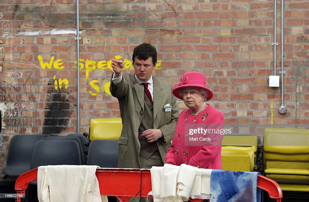 Queen <a gi-track='captionPersonalityLinkClicked' href=/galleries/search?phrase=Elizabeth+II&family=editorial&specificpeople=67226 ng-click='$event.stopPropagation()'>Elizabeth II</a> is shown around the backstage area of the recently refurbished Bristol Old Vic Theatre by artistic director Tom Morris (L) on a visit to Bristol as part of her Jubilee Tour on November 22, 2012 in Bristol, England.