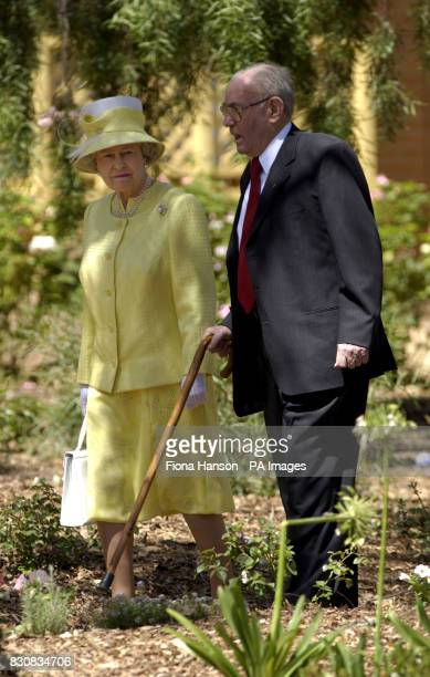 Queen Elizabeth II is shown around the Chateau Barrosa vineyards by owner Hermann Thumm during a visit She had travelled to the winegrowing area...