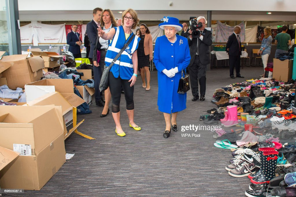 Queen Elizabeth II is shown donations of aid made by members of the local community by Executive Director of Kensington and Chelsea Council Sue Harris during a visit to the Westway Sports Centre which is providing temporary shelter for those who have been made homeless in the disaster on June 16, 2017 in London, England. 30 people have been confirmed dead and dozens still missing, after the 24 storey residential Grenfell Tower block in Latimer Road was engulfed in flames in the early hours of June 14. Emergency services will spend a third day searching through the building for bodies. Police have said that some victims may never be identified.