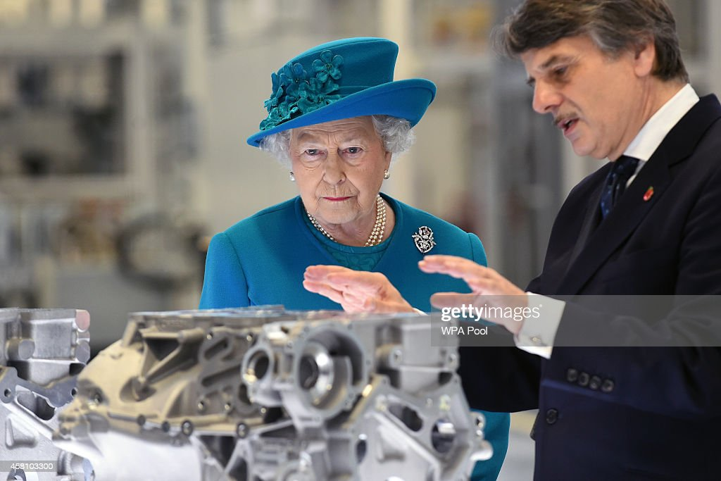 Queen Elizabeth II is shown engine parts by chief executive Dr Ralf Speth during a tour of the new Jaguar Land Rover Engine Manufacturing Centre in...