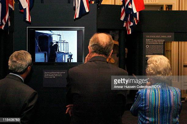 HM Queen Elizabeth II is shown Gaumont and British Pathe newsreel footage of King George VI and Queen Elizabeth's State Visit to France in July 1938...