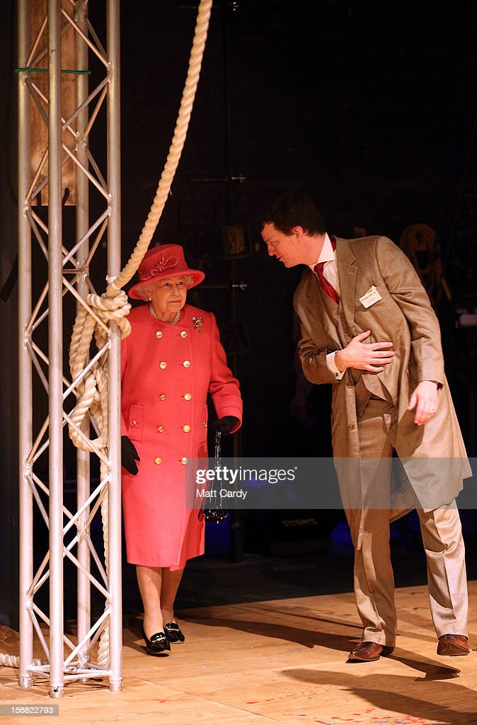 Queen <a gi-track='captionPersonalityLinkClicked' href=/galleries/search?phrase=Elizabeth+II&family=editorial&specificpeople=67226 ng-click='$event.stopPropagation()'>Elizabeth II</a> is shown onto the stage of the recently refurbished Bristol Old Vic Theatre by artistic director Tom Morris (R) on a visit to Bristol as part of her Jubilee Tour on November 22, 2012 in Bristol, England.