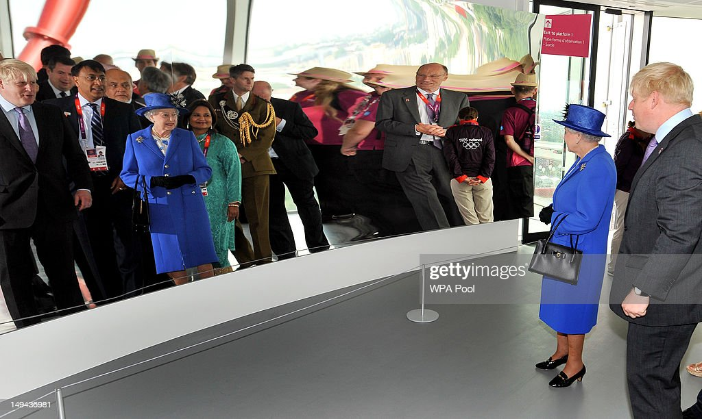Queen Elizabeth II is shown the curved mirror by London Mayor Boris Johnson at the top of the Orbit, during a short tour of the Olympic site on day one of the London 2012 Olympics Games on July 28, 2012 in London, England.
