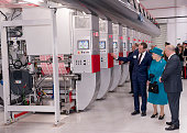 Queen Elizabeth II is shown the printing press by print service manager David Blurton MD Ian White during an official visit to International Security...