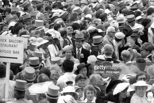 Queen Elizabeth II is surrounded by a sea of faces as she arrives at Royal Ascot Behind her left smiling with top hat is Chief Superintendent Jim...