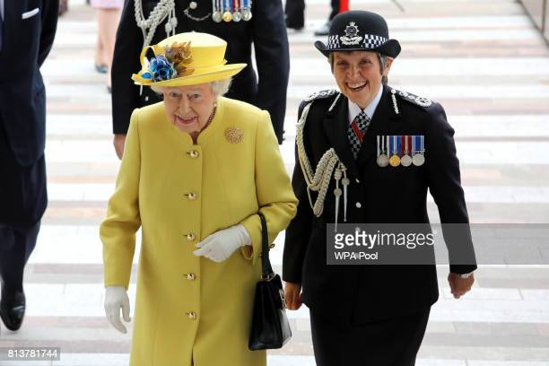 Queen Elizabeth II is welcomed by Commissioner of the Metropolitan Police Cressida Dick during the opening of the the new headquaters of the...