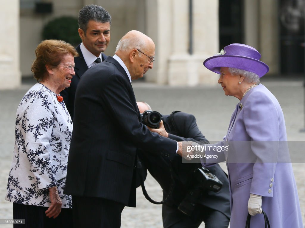 Queen Elizabeth II (R) is welcomed by talian President Giorgio Napolitano (3rdL) and his wife Clio Maria Bittoni Napolitano (L) at the Qurinale Palace in Rome, Italy on April 3, 2014.