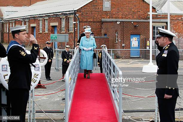 Queen Elizabeth II is welcomed on board HMS Lancaster at Portsmouth Naval Base where the queen visited the ship on May 20 2014 in Portsmouth England...