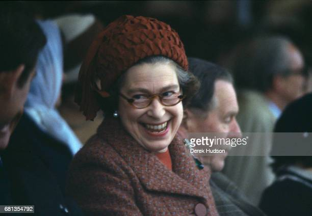 Queen Elizabeth II laughs as she attends the Royal Windsor horse show Windsor England 1975