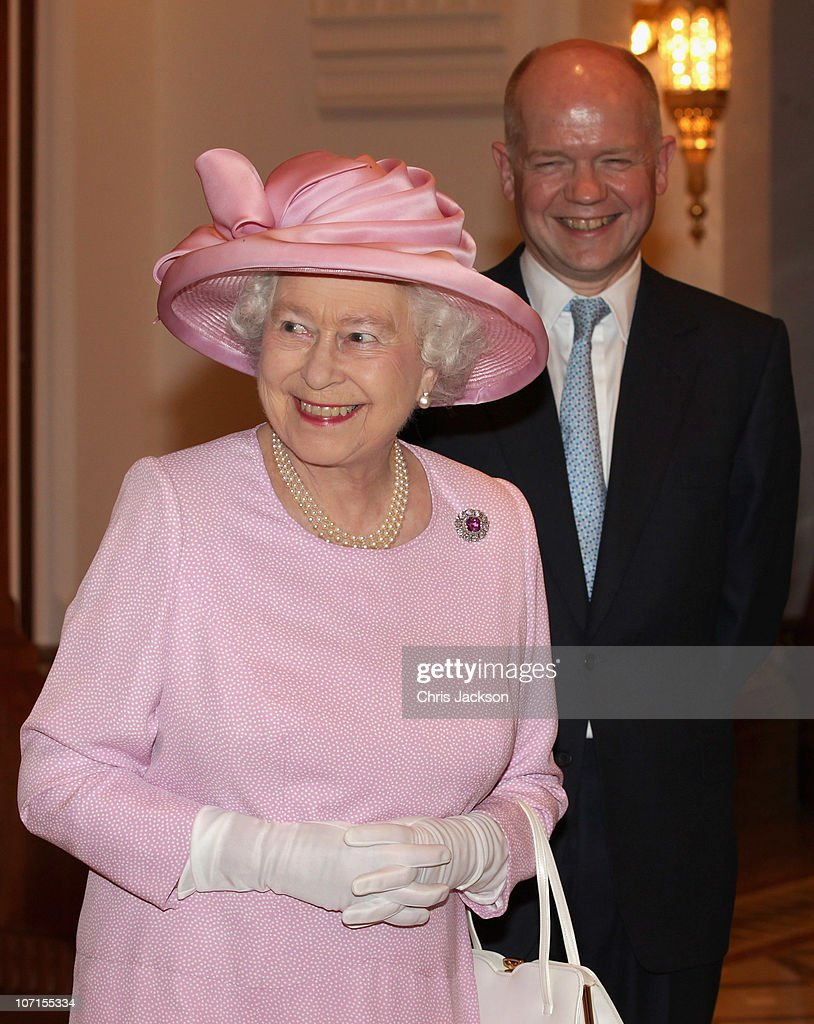 Queen Elizabeth II laughs with Foreign & Commonwealth Secretary William Hague during a Tate Gallery event as they visit Al-Alam Palace on November 26, 2010 in Muscat, Oman. Queen Elizabeth II and Prince Philip, Duke of Edinburgh are on a State Visit to the Middle East. The Royal couple have spent two days in Abu Dhabi and three days in Oman.
