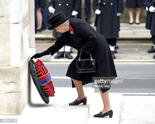 Queen Elizabeth II lays a wreath during the annual Remembrance Sunday Service at the Cenotaph Whitehall on November 8 2015 in London England