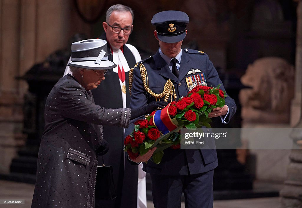 Queen <a gi-track='captionPersonalityLinkClicked' href=/galleries/search?phrase=Elizabeth+II&family=editorial&specificpeople=67226 ng-click='$event.stopPropagation()'>Elizabeth II</a> lays a wreath made of roses and bay leaves on the Grave of the Unknown Warrior at a Service on the Eve of the Centenary of the Battle of the Somme at Westminster Abbey on June 30, 2016 in London, United Kingdom.