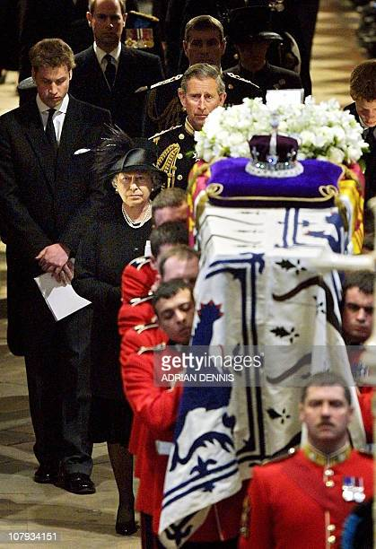 Queen Elizabeth II leads her family as she follows pall bearers carrying the coffin of Queen Elizabeth the Queen Mother out of Westminster Abbey...