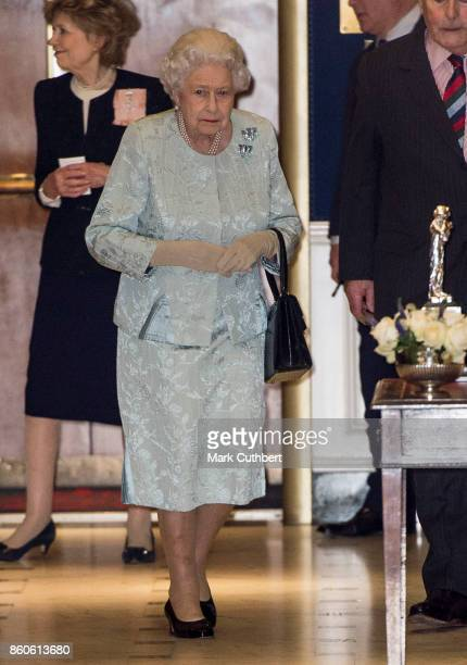 Queen Elizabeth II leaves after a reception to mark the Centenary of the Women's Royal Navy Service and the Women's Auxiliary Army Corp at The Army...