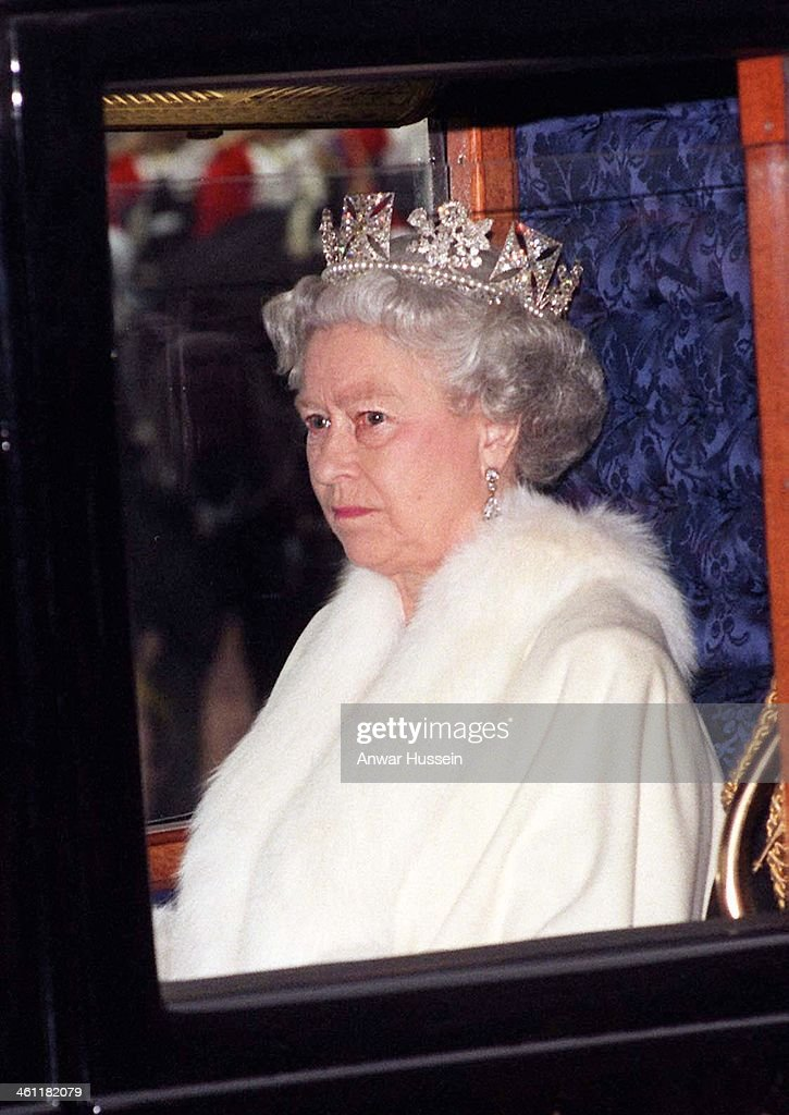Queen Elizabeth II leaves Buckingham Palace by coach to attend the State Opening of Parliament on November 24, 1998 in London, England .