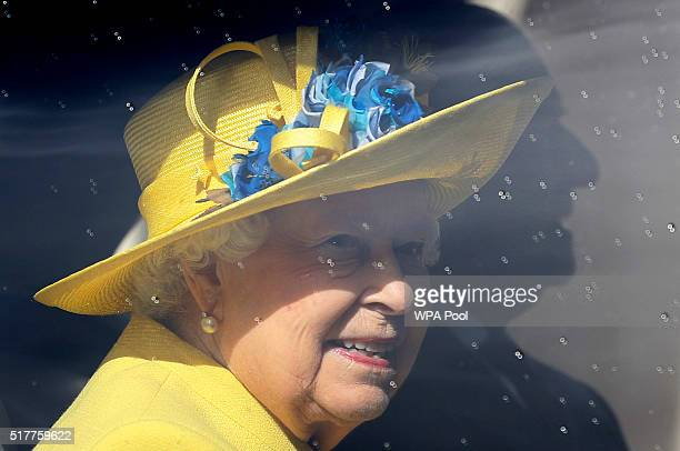 Queen Elizabeth II leaves in a car after attending the Easter Mattins service at St George's Chapel Windsor Castle on March 27 2016 in Windsor England