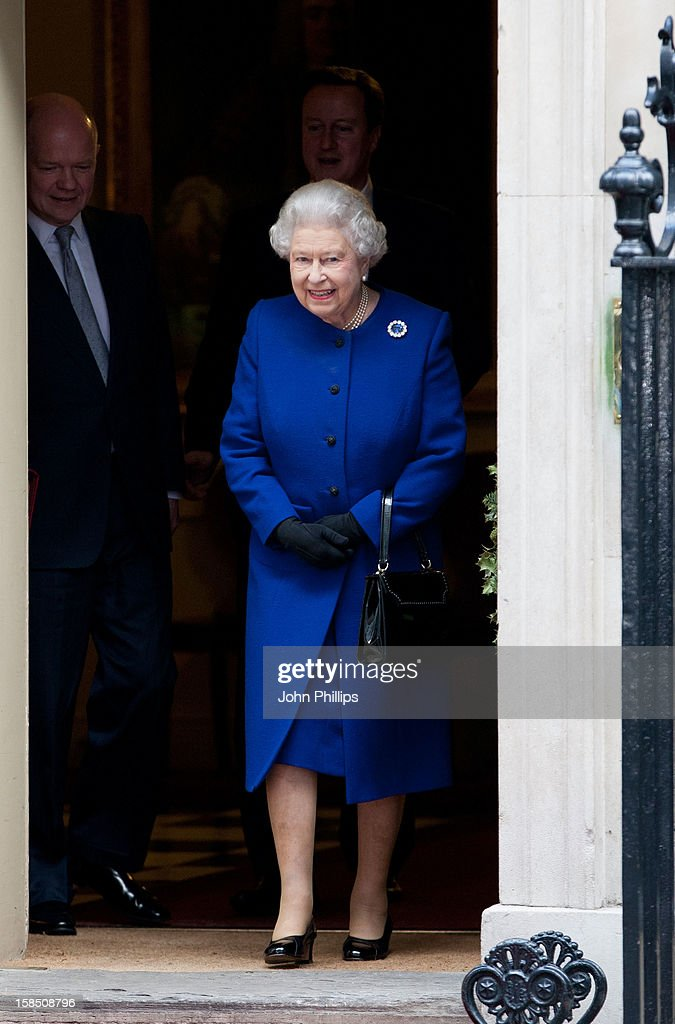 Queen Elizabeth II leaves Number 10 Downing Street after attending the Government's weekly Cabinet meeting on December 18, 2012 in London