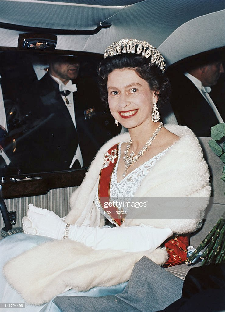 Queen Elizabeth II leaves Schloss Augustusburg in Bruhl, Germany, after attending a State Reception, May 1965. She is wearing the Jubilee Necklace and a diamond bow brooch with pearl drop inherited from Queen Mary.