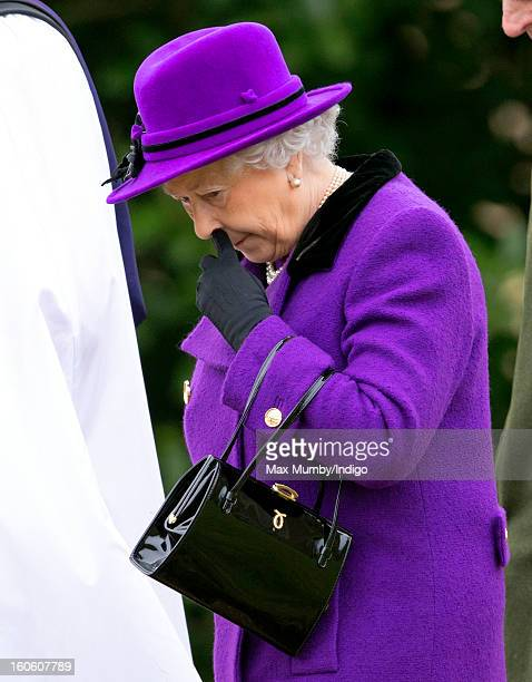 Queen Elizabeth II leaves the church of St Peter and St Paul in West Newton after attending Sunday service on February 03 2013 near King's Lynn...