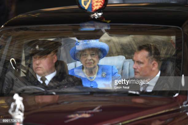 Queen Elizabeth II leaves the Houses of Parliament on June 21 2017 in London England This year saw a scaledback State opening of Parliament Ceremony...
