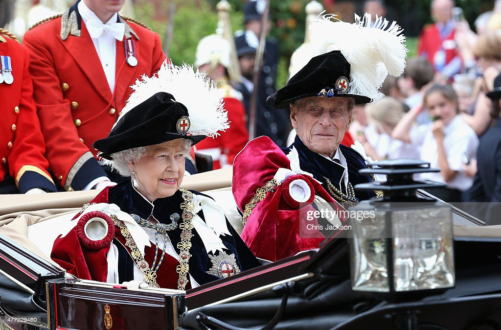 Queen Elizabeth II leaves the Order of the Garter Service at St George's Chapel in a royal carriage at Windsor Castle on June 15, 2015 in Windsor, England. The Order of the Garter is the most senior and the oldest British Order of Chivalry and was founded by Edward III in 1348.