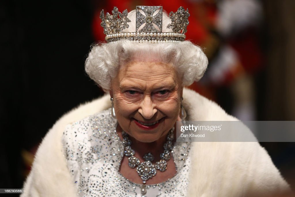 Queen Elizabeth II leaves through the Norman Porch of the Palace of Westminster after the State Opening of Parliament on May 8, 2013 in London, England. Queen Elizabeth II unveiled the coalition government's legislative programme in a speech delivered to Members of Parliament and Peers in The House of Lords. Proposed legislation is expected to be introduced on toughening immigration regulations, capping social care costs in England and setting a single state pension rate of 144 GBP per week.