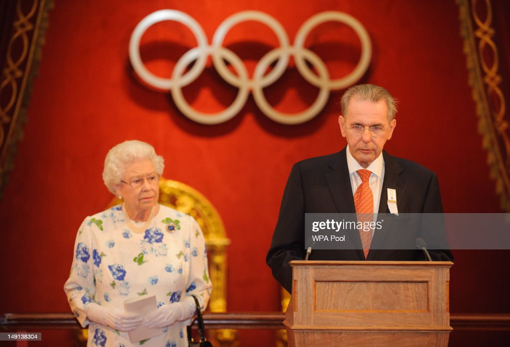 Queen <a gi-track='captionPersonalityLinkClicked' href=/galleries/search?phrase=Elizabeth+II&family=editorial&specificpeople=67226 ng-click='$event.stopPropagation()'>Elizabeth II</a> listens as President of the International Olympic Committee Count <a gi-track='captionPersonalityLinkClicked' href=/galleries/search?phrase=Jacques+Rogge&family=editorial&specificpeople=206143 ng-click='$event.stopPropagation()'>Jacques Rogge</a> speaks at a reception for members of the International Olympic Committee at Buckingham Palace on July 23, 2012 in London, England.