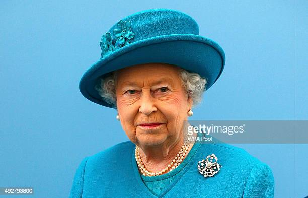 Queen Elizabeth II listens to a speech after unveiling a plaque at the new School of Veterinary Medicine at the University of Surrey on October 15...