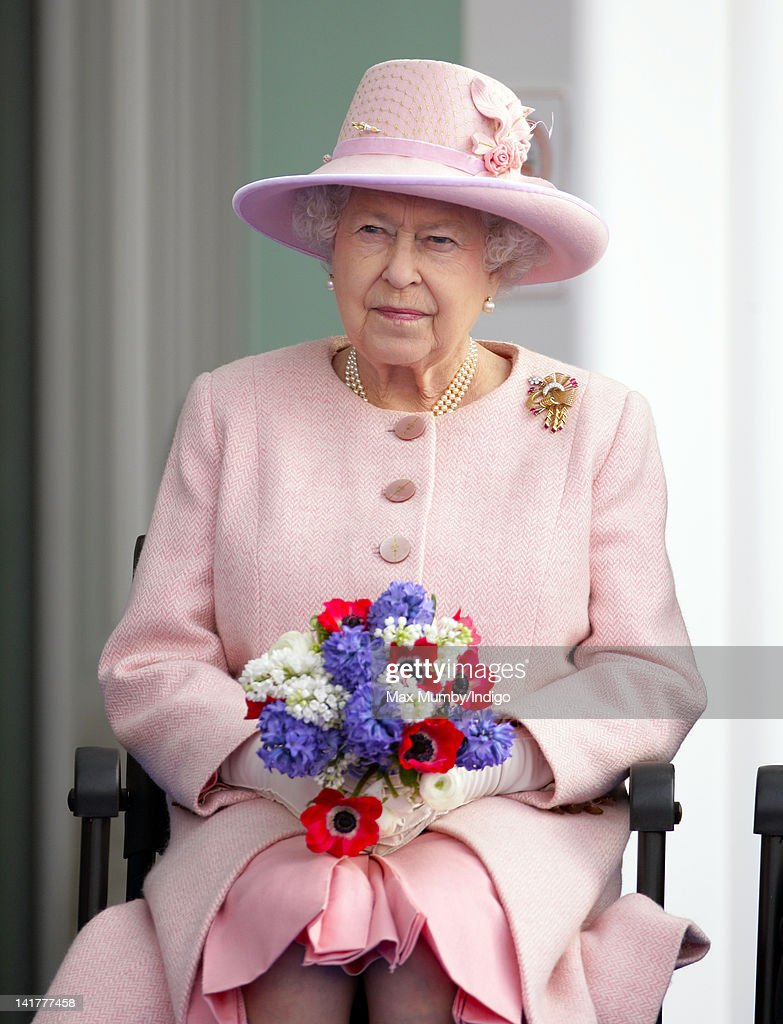 Queen <a gi-track='captionPersonalityLinkClicked' href=/galleries/search?phrase=Elizabeth+II&family=editorial&specificpeople=67226 ng-click='$event.stopPropagation()'>Elizabeth II</a> listens to a speech as she, accompanied by Prince Philip, Duke of Edinburgh visits St Mary's Hospital and the Manchester Royal Eye Hospital as part of her Diamond Jubilee Tour of the UK on March 23, 2012 in Manchester, England.