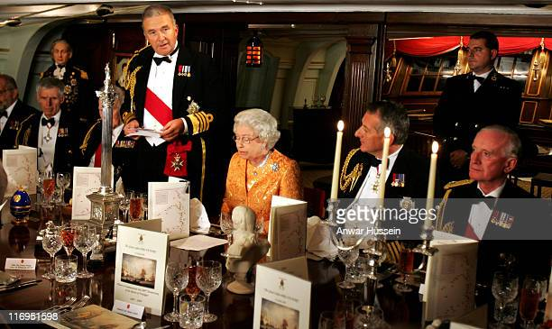 Queen Elizabeth II listens to a speech by First Sea Lord Admiral Sir Alan West on board HMS Victory at Portsmouth Naval base on Oct 21 at the 200th...