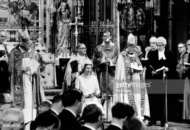 Queen Elizabeth II listens to an address by the Archbishop of York Dr Donald Coggan right during a service at Westminster Abbey to inaugurate the new...