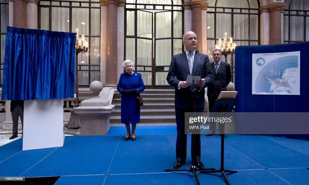 Queen <a gi-track='captionPersonalityLinkClicked' href=/galleries/search?phrase=Elizabeth+II&family=editorial&specificpeople=67226 ng-click='$event.stopPropagation()'>Elizabeth II</a> listens to British Foreign Secretary <a gi-track='captionPersonalityLinkClicked' href=/galleries/search?phrase=William+Hague&family=editorial&specificpeople=206295 ng-click='$event.stopPropagation()'>William Hague</a> announce that a 169,000-sq. mile (437,000-sq. kilometer) section of the British Antarctic Territory has been renamed Queen Elizabeth Land to mark the monarch's 60 years on the throne as she tours The Foreign and Commonwealth Office during an official visit which is part of her Jubilee celebrations on December 18, 2012 in London, England.