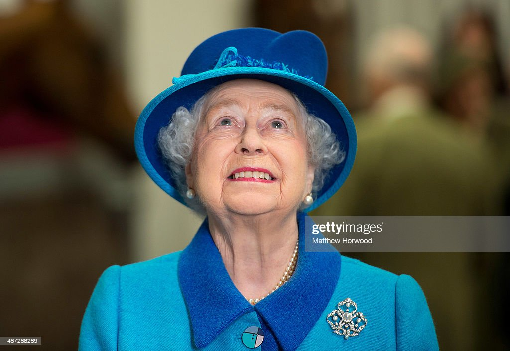 Queen Elizabeth II looks at a plaque on a wall during an official visit to Cotts Farm Equine Hospital, Narbeth on April 29, 2014 in Narbeth, Wales. The Cotts Equine Hospital is a purpose-built facility offering veterinary equine care.