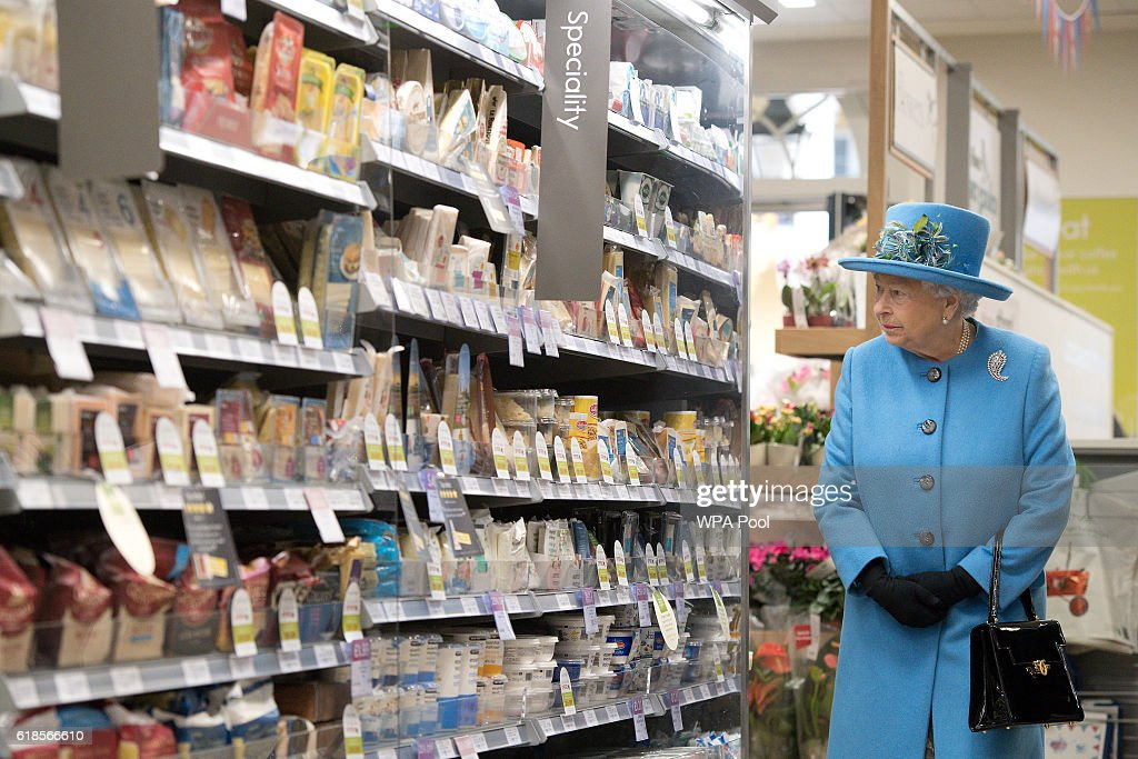 Queen Elizabeth II looks at products on the shelves at a Waitrose supermarket during a visit to the town of Poundbury on October 27, 2016 in Poundbury, Dorset. Poundbury is an experimental new town on the outskirts of Dorchester in southwest England designed with traditional urban principles championed by The Prince of Wales and built on land owned by the Duchy of Cornwall.