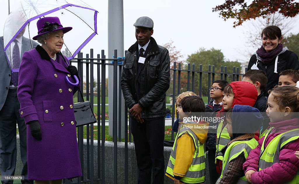 Queen <a gi-track='captionPersonalityLinkClicked' href=/galleries/search?phrase=Elizabeth+II&family=editorial&specificpeople=67226 ng-click='$event.stopPropagation()'>Elizabeth II</a> looks at school children in a playground as she attends the opening of the recently re-built Jubilee Gardens on October 25, 2012 in London, England. The recent transformation of the Jubilee Gardens was completed 35 years after they were first created in 1977 to celebrate The Queen's Silver Jubilee.