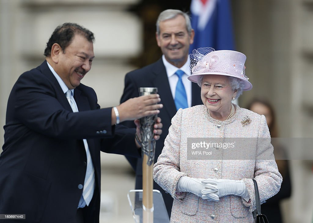 Queen <a gi-track='captionPersonalityLinkClicked' href=/galleries/search?phrase=Elizabeth+II&family=editorial&specificpeople=67226 ng-click='$event.stopPropagation()'>Elizabeth II</a> looks on as Prince Imran, President of the Commonwealth Games Federation closes the baton after she placed her message inside for the host city during the 2014 Glasgow Commonwealth Games Baton relay launch ceremony at Buckingham Palace on October 9, 2013 in London, England. After presenting the baton to Queen <a gi-track='captionPersonalityLinkClicked' href=/galleries/search?phrase=Elizabeth+II&family=editorial&specificpeople=67226 ng-click='$event.stopPropagation()'>Elizabeth II</a>, the relay will continue it's journey visiting all 70 competing nations and territories ahead of the Commonwealth Games in Glasgow in 2014.