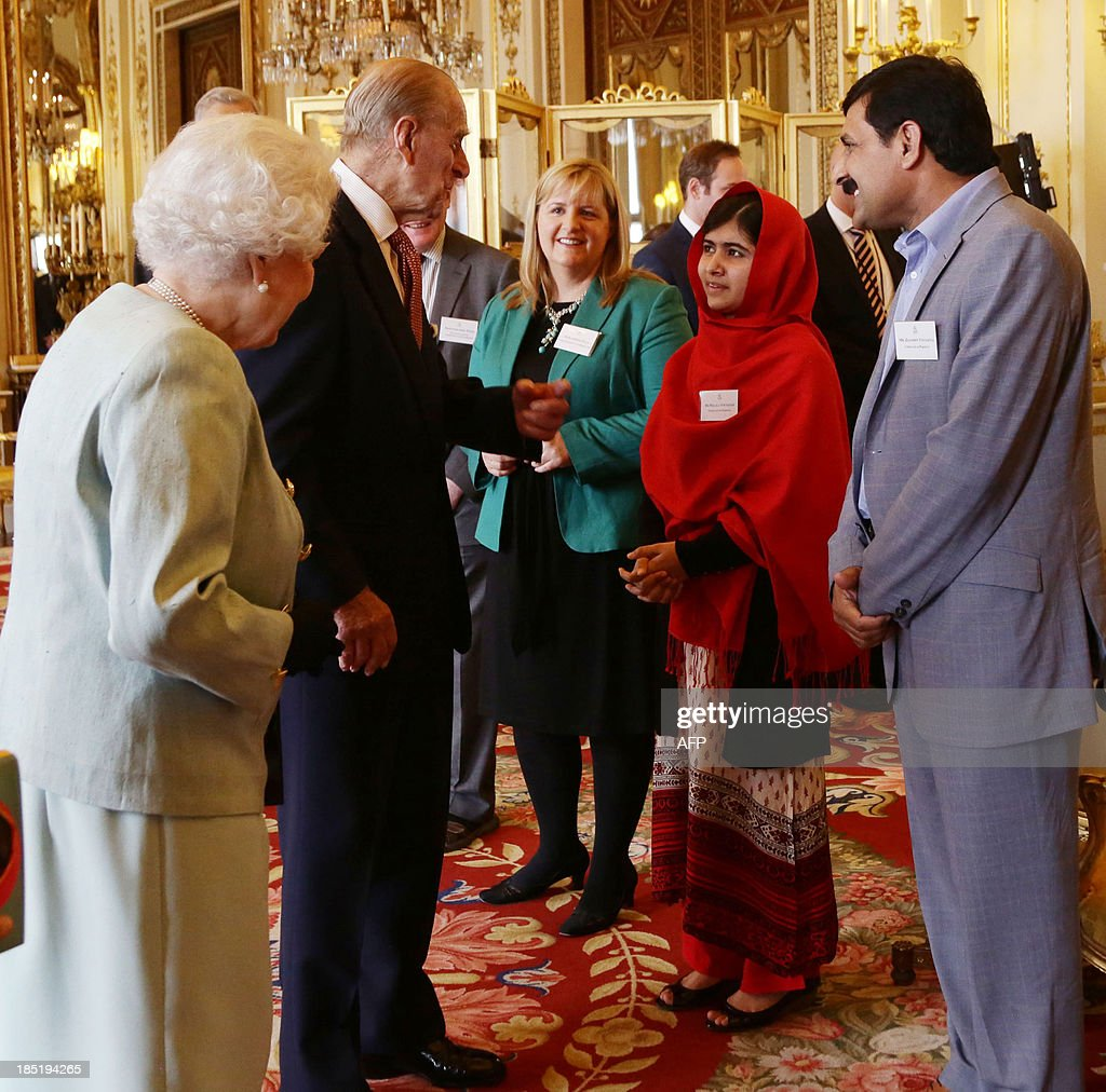 Queen Elizabeth II looks on as Prince Phillip, The Duke of Edinburgh (2-L) speaks with Malala Yousafzai (2-R) and her father Ziauddin Yousafzai (R) during a Reception for Youth, Education and the Commonwealth at Buckingham Palace in London on October 18, 2013. The 16-year-old, who was shot by the Taliban for championing girls' rights to an education, met Queen Elizabeth at a reception for youth, education and the Commonwealth. Prince Philip, 92, joked that in Britain, people wanted their children to go to school to get them out of the house -- a comment that left Malala covering her face in a fit of giggles. AFP PHOTO/POOL/Yui Mok