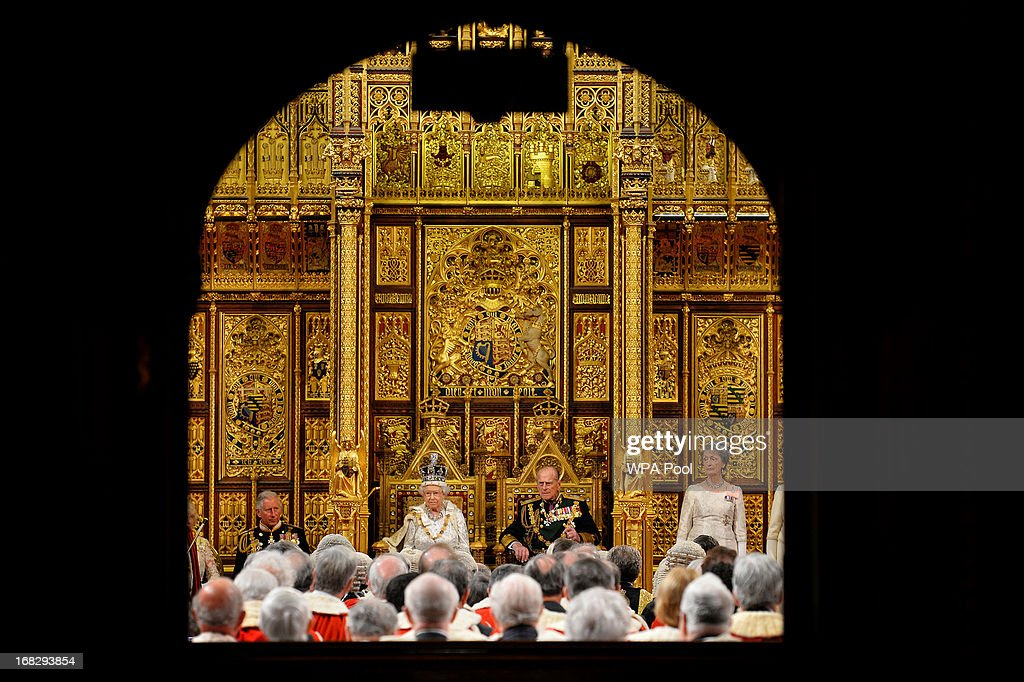 Queen Elizabeth II looks on before delivering her speech during the State Opening of Parliament at the House of Lords, alongside Prince Philip, The Duke of Edinburgh (R) and Prince Charles, Prince of Wales (L) on May 8, 2013 in London, England. Queen Elizabeth II unveils the coalition government's legislative programme in a speech delivered to Members of Parliament and Peers in The House of Lords. Proposed legislation is expected to be introduced on toughening immigration regulations, capping social care costs in England and setting a single state pension rate of 144 GBP per week.