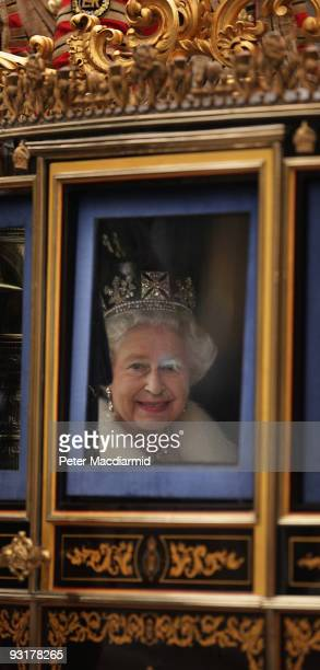 Queen Elizabeth II looks out from the State Coach as she returns to Buckingham Palace after the State Opening of Parliament on November 18 2009 in...