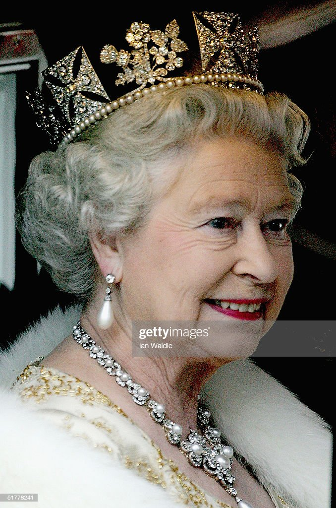 Queen Elizabeth II looks out of the window of her carriage as ahe arrives for the state opening of Parliament November 23 2004 in London In her...