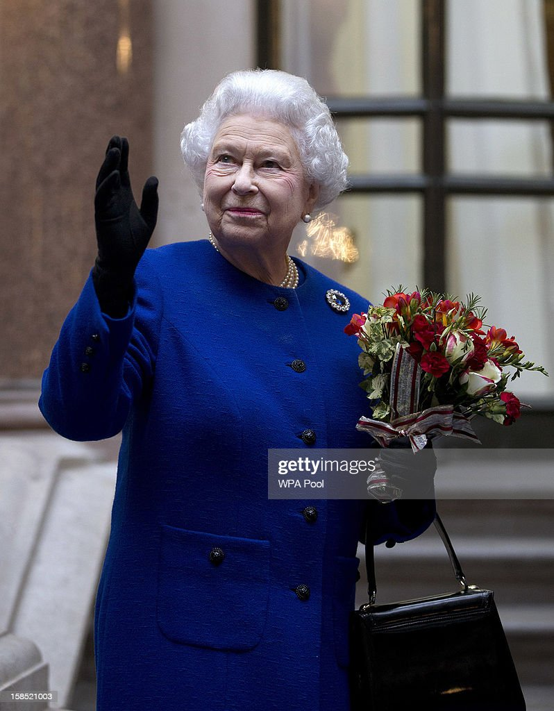 Queen <a gi-track='captionPersonalityLinkClicked' href=/galleries/search?phrase=Elizabeth+II&family=editorial&specificpeople=67226 ng-click='$event.stopPropagation()'>Elizabeth II</a> looks up and waves to members of staff of The Foreign and Commonwealth Office as she ends an official visit which is part of her Jubilee celebrations on December 18, 2012 in London, England.