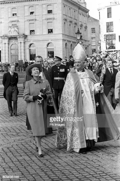 Queen Elizabeth II looks up at the west face of Exeter Cathedral as she arrived for the Royal Maundy service accompanied by the Lord Bishop of Exeter...